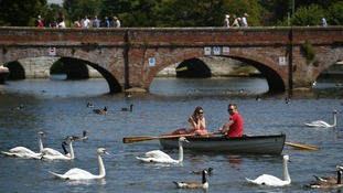 People make the most of the warm weather on the River Avon in Stratford-upon-Avon.