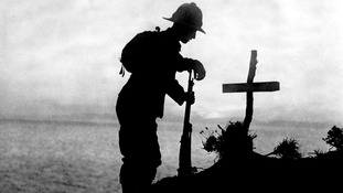 A British soldier pays his respects at the grave of a colleague near Cape Helles, where the Gallipoli landings took place.