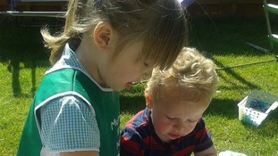 Lexie, aged 5, and Mason, aged 2, enjoying painting in the sun in sunny Fakenham.