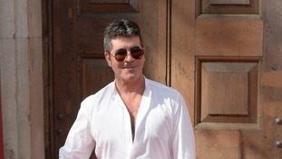 Simon Cowell's spokesman responds to claims the X Factor boss is gay.