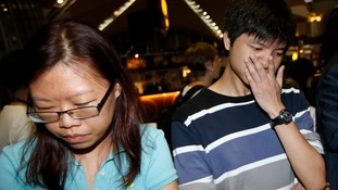 People, who said they believed their relatives were on Malaysia Airlines flight MH17