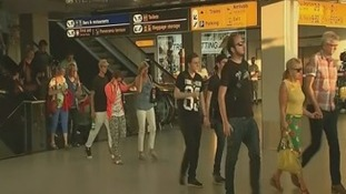 Passengers seen leaving Amsterdam's international airport