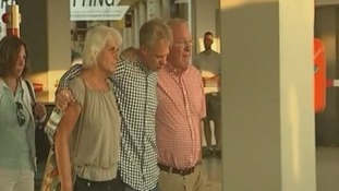 Passengers seen being comforted as news of the Malaysia Airlines plane rolls in