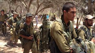 Israeli troops mustering near the border.