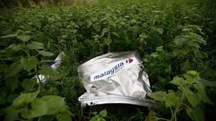 Debris from the Malaysian Airlines passenger plane that crashed last night killing 298 people.
