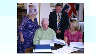 Sir Tom's family accept the Books of Condolence.