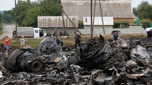 Debris is seen at the site of Thursday's Malaysia Airlines Boeing 777 plane crash