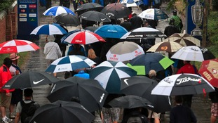 Crowds with umbrellas at Open Championship