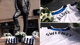 Tributes to Liam Sweeney and John Alder outside Newcastle's St James' Park stadium.