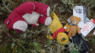 Toys and books lay scattered along the ground.
