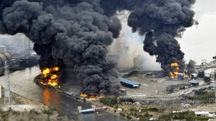 A factory burns following an earthquake and tsunami in Sendai in March 2011