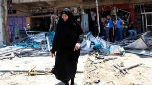 A woman weeps at the scene of a bomb site in Baghdad.