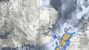 Satellite and rainfall radar image taken at 11.30am on Sunday 20 July 2014.