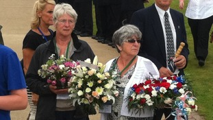 families laying wreaths