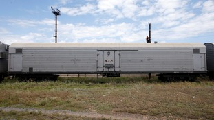 A picture of a train wagon in eastern Ukraine reportedly being used to store bodies of victims.