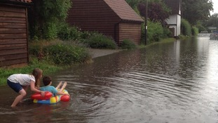 Evie (8) and Joseph (5) making the most of the flooding at Gt Staughton in Cambridgeshire.