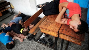 Palestinians sleep at a UN school after fleeing heavy shelling in the Shejaia neighbourhood.