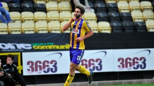 Will Grigg celebrates scorning for Brentford.