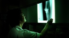 Shot of nurse looking at x ray