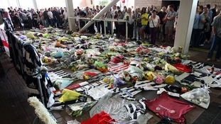 Red and white Sunderland shirts are seen among the Newcastle strips at a memorial for the two fans.