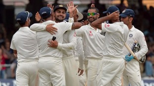 India celebrate beating England.