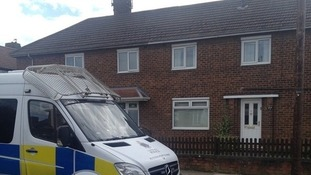 A police van outside Irene Collins' home in Middlesbrough.