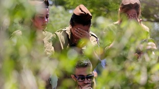 Israeli soldiers mourn during the funeral of a comrade.
