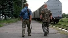Train carrying bodies of MH17 victims departs for Kharkiv