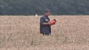 A man on the scene on Friday pictured holding what appears to be a black box recorder.