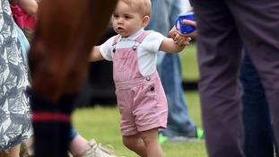 Prince George appears to be interested in the horses in June 2014