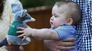 Prince George clasps a toy Bilby during his visit to Taronga Zoo in Australia in April 2014