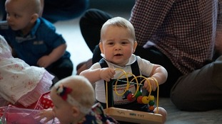 Prince George plays with toys on the floor of the playgroup in April 2014