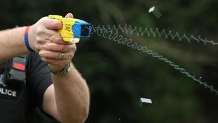 Police officer holding a Taser