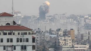 Flames and smoke are seen following what witnesses said was an Israeli air strike