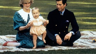 Prince William with his proud parents.