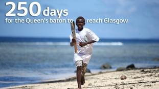 A boy from the Solomon Islands carrying the Queen's baton on its way to Glasgow.