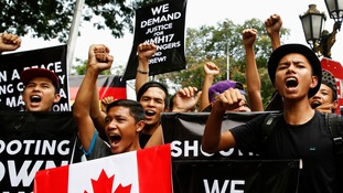 Demonstrators chant slogans outside the Russian embassy in Kuala Lumpur.