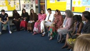 Malala Yousafzai joins women to make a speech at the GirlsSummit.