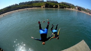The fisheye lens captured people jumping in the water at Cullercoats, North Tyneside as temperatures hit the high 20s.