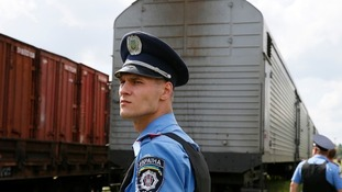 The train carrying victims from MH17 arrives at Kharkiv, Ukraine.