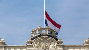 The Dutch flag flies at half-staff at the Kneuterdijk Palace in The Hague