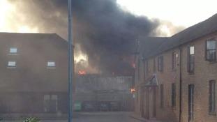 Thick dark smoke from fire in Dachet