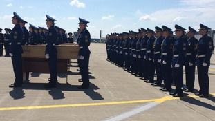 A ceremony is held for the victims before coffins are boarded on the plane.