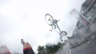 Bike somersaults through the air after crash