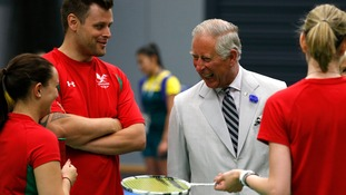 Prince Charles greets members meets members of the Wales badminton team during the build-up to Glasgow's 2014 Commonwealth Games opening ceremony.