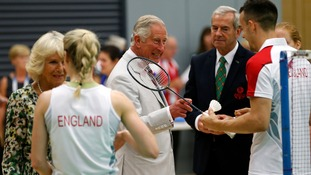 Prince Charles and Camilla, Duchess of Cornwall, with members of the England badminton team during a visit to the Commonwealth Arena and Velodrome in Glasgow.