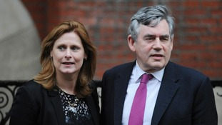 Gordon Brown and his wife Sarah arrive at the Leveson Inquiry.