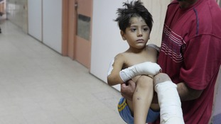 A child is carried in Khan Yunis Hospital in Gaza.