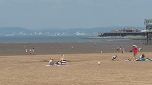 Holidaymakers enjoying the sun at West super Mare