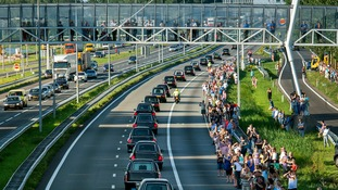 Thousands turn out to line the route of a convoy of hearses, bearing remains of the victims of the Malaysia Airlines Flight MH17 crash, as they make their way to Hilversum, Holland.
